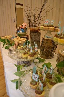woodland baby shower. Love the wooden stumps to display food.