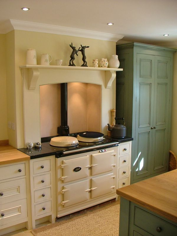 Rustic style kitchen showing an over mantel supported by carved corbels. You can buy similar corbels online at www.buycarvings.co.uk