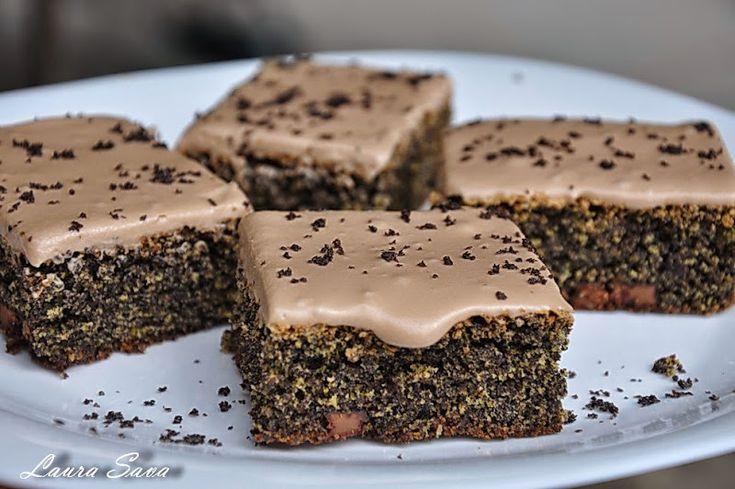 Prajitura cu mac mai buna nu cred ca ati mancat vreodata!!! :P. Asta e prajitura suprema cu mac...mai ales ca are si glazura de ciocolata!!!!!!! Ingrediente: - 5 oua - 180 g. zahar - 2 linguri ulei - 2 linguri Brandy/Rom - 2 linguri (cu varf) pesmet - 250 g. mac macinat - 100 g. ciocolata cu lapte - 100 g. stafide (optional) Glazura: - 100 g. ciocolata amaruie sau cu lapte - 60 ml. smantana dulce pentru frisca (frisca lichida) Mod de preparare: Se incalzestecuptorulla foc mediu(180 gra...