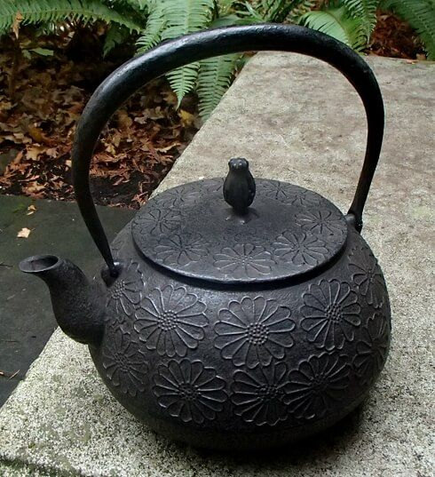 This rare and magnificent Japanese iron Tetsubin is covered in raised chrysanthemums with a rich cocoa brown finish. This cast iron water kettle does not have an enamel interior.  You may use this Tetsubin kettle to boil water.  In fact, I recommend it! From Mizusawa, Iwate Prefecture Made in Japan.