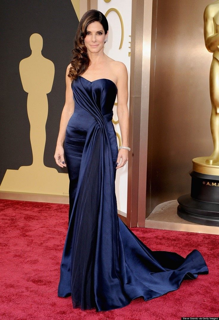 The great actress Sandra Bullock wore this midnight blue dress last year at the Oscars, when she was nominated for her role in Gravity. The dress is designed by one of the greatest fashion houses, Alexander McQueen. #redcarpet