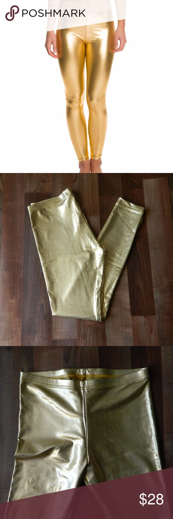 "American Apparel Lame Gold Metallic Leggings Brand new with tags American Apparel leggings. Size large. Made of nylon and elastane. Measurements: 15"" - 20"" waist, one pant is a little longer than the other (IDK why) 26"" inseam on the left leg and 27.5"" inseam on the right leg. Not noticeable if you wear them with boots! :) No trades. Open to reasonable offers. Happy Poshing! American Apparel Pants Leggings"