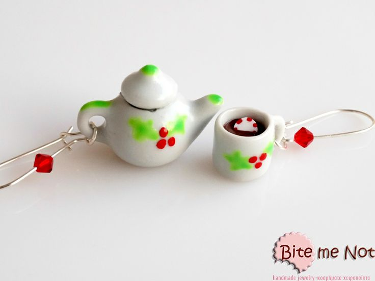 ''Christmas ceramic set'' -Silver plated hook earrings decorated with red beads!  -Ceramic set of tea pot and mug decorated with handpainted mistletoes! The mug is fulll of hot chocolate and a peppermint candy is dipped in!