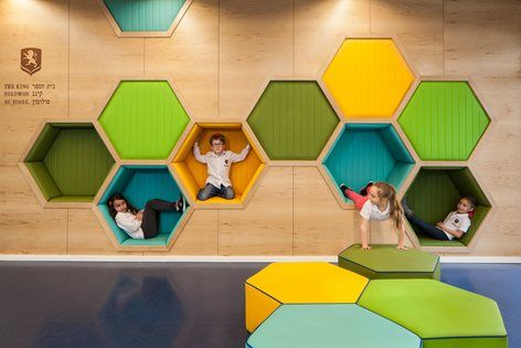 The design concept is based on the wish to translate the pedagogical - philosophical idea of the holistic education to an exciting learning experience The star of David symbol was the formal inspiration for the design. The inner shape- created from...