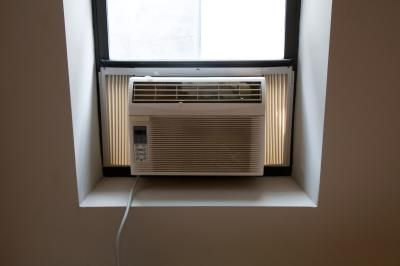 In the winter, window air conditioners can be hidden behind bookshelves, other furniture or folding floor screens. In the summer, however, the front of the air conditioner must be free of  ...