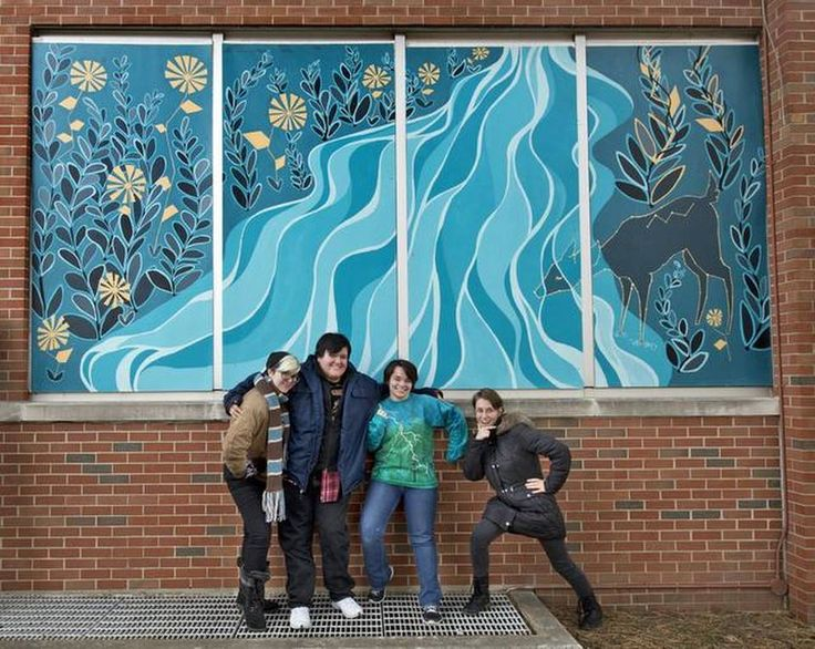 Kansas City Art Institute students have created murals for the outside of the vacant Scarritt Elementary School at 3509 Anderson Ave. in northeast Kansas City. Jessica Becker (from left), Tobias Rose, Maria Dlabick and Eren Mulhausen posed with their work.