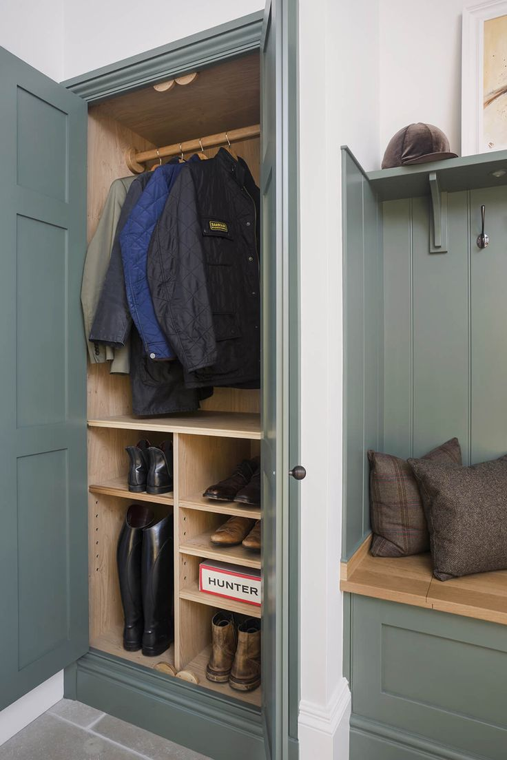 Wardrobe and shelves either side of a bench seat a must in a functional mudroom. Must store shoes, hats and jackets