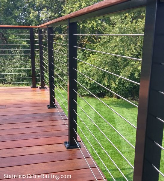 New deck in Woodsbury MN, using customer-sourced wood with black aluminum posts and cable infill from Stainless Cable & Railing.