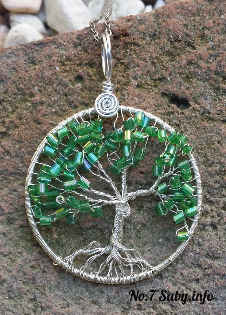 Wire Tree Pendant. No.7 Silver with green rods. (4 cm). Han-made by Sabine Stroo - van de Flier. Sold