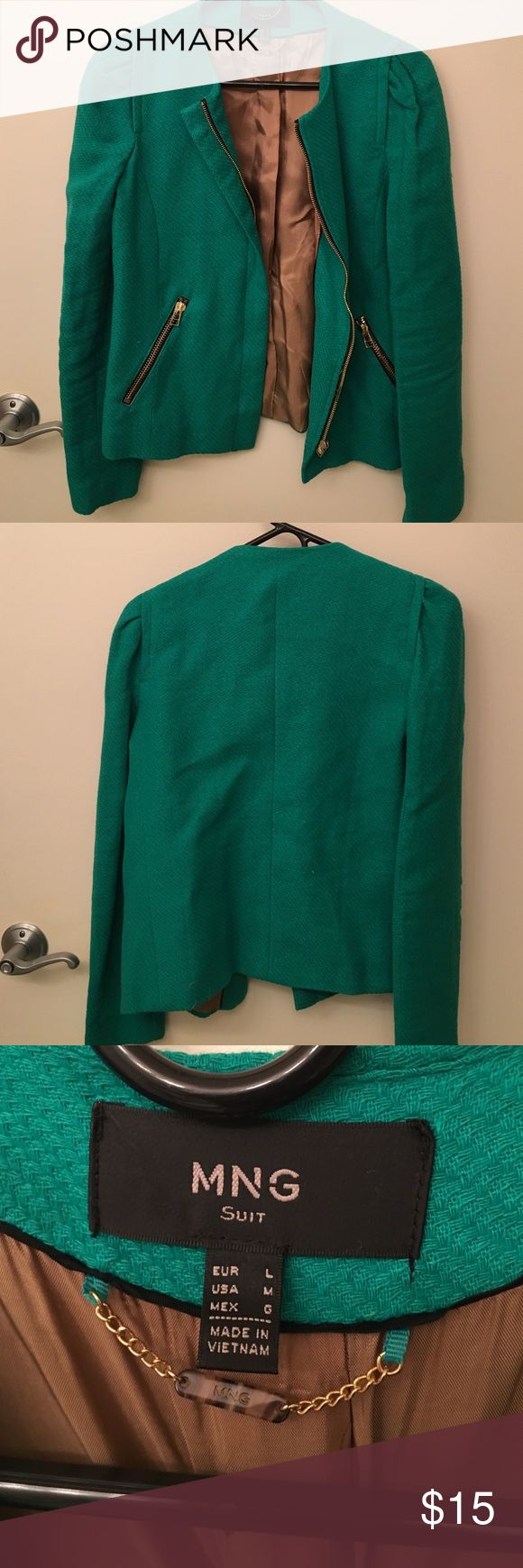 Green MNG by Mango Blazer This is a bright vibrant emerald green color, it comes across a little dull in the pictures. Originally it came with shoulder pads that were taken out and removed by a tailor. But I think they left the shoulders slightly off. Gold hardware. MNG by Mango Jackets & Coats Blazers