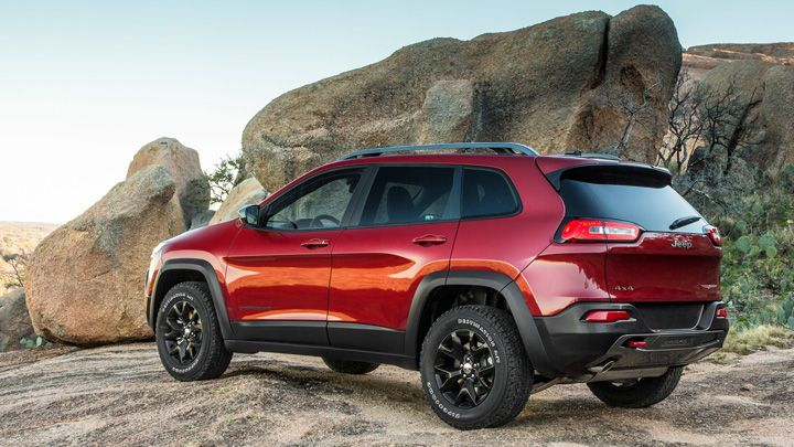 2014 Jeep® Cherokee Trailhawk® shown in Deep Cherry Red. Late Availability.