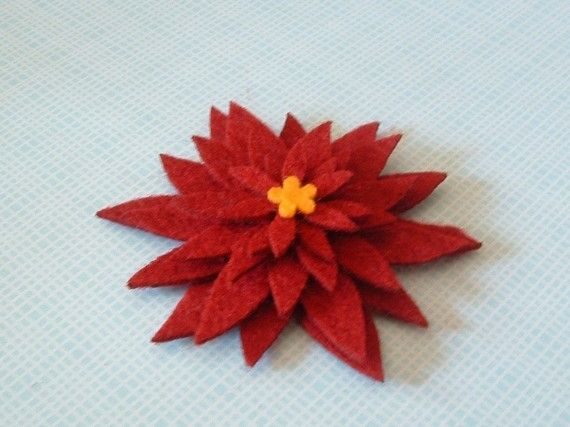 The possibilities are endless with these pretty poinsettia felt appliques! From Kutz on Etsy! See other winter items like snowflakes!