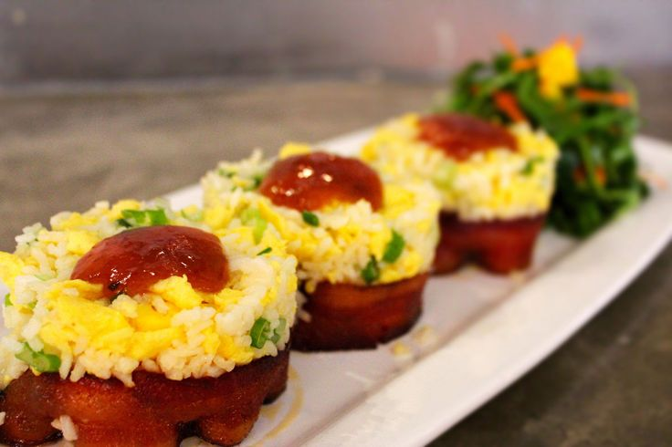Breakfast Sushi 3 thick bacon rolls (baked w/brown sugar + paprika) + rice + scrambled eggs + scallions. fresh fruit + plum sauce:  fig-tree-cafe
