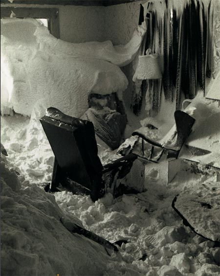 "The Great Blizzard of January 1977 in the Buffalo, New York region was so intense that wind gusts up to hurricane speed smashed windows in homes allowing the up to 70"" of snow accumulations and drifts 20 to 30 feet deep to penetrate into the living spaces of unfortunate victims of the storm. The blizzard and the entire winter of 1976-1977 were so extreme that some climate scientists at the time believed it was the beginning of a new 'Little Ice Age'."