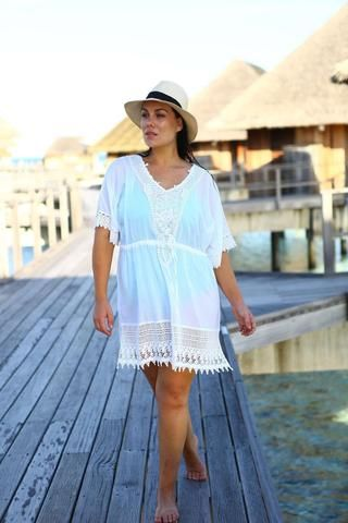 The White Chatilly Dress from jamjam Clothing can be worn as a stand alone dress or combined with shorts or leggings. The  Chantilly White Kaftan is designed with a gorgeous v-cut neckline and can be enhanced with any accessories you wish such as crystals, beads or a summer necklace. Make a statement by wearing this beautifully crafted summer kaftan and enjoy all that the summer days has to offer