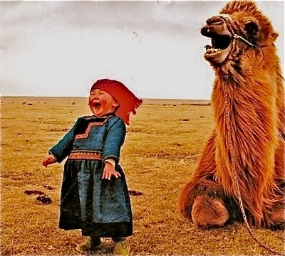 Joy. [Mongolian(?) girl and a Bactrian camel. Anybody know the original source?],