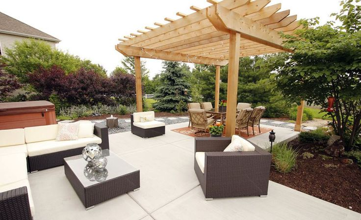 Contemporary backyard patio with wood pergola kit