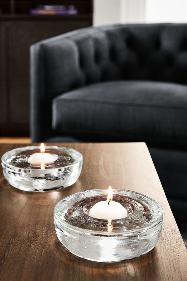 This pressed glass candle holder is handcrafted by pressing molten glass into a specially made mold and each one is signed and numbered by the artisans at Hennepin Made.