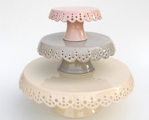 Tiered cake stands with decorative scalloped lace edges -- yes, please!....these are absolutely beautiful hand made ceramic stands..... look up the site....