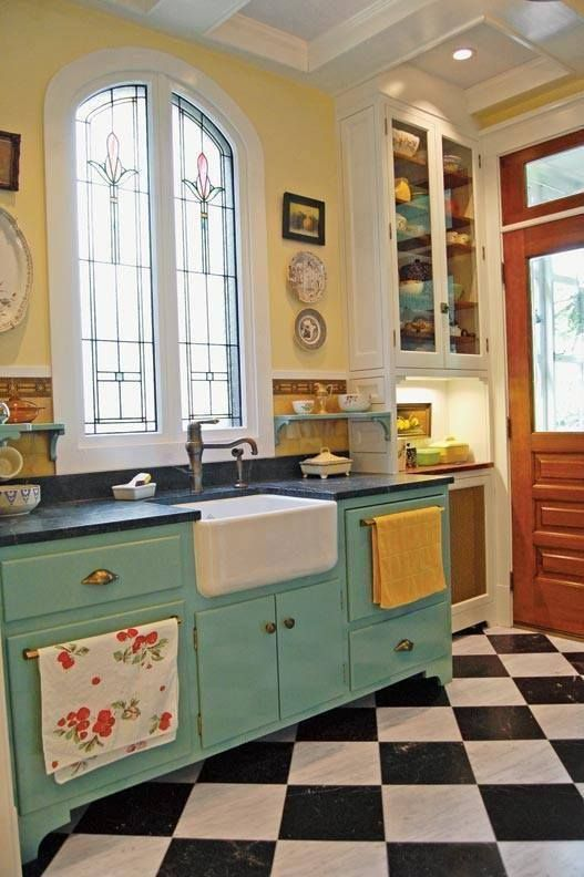 I love the window, the blue cabinets, the farm house sink, those towel bar/drawer handles. I wonder if those are a dish washer and mini-fridge? I love that built in hutch, the back door and the floor. OK - I think that's everything because I really love it all!