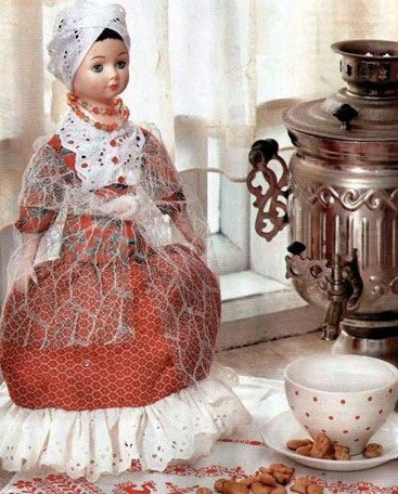 A doll teapot cover in the Russian traditional costume.
