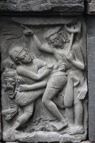 Relief at Prambanan temple.What are they doing?