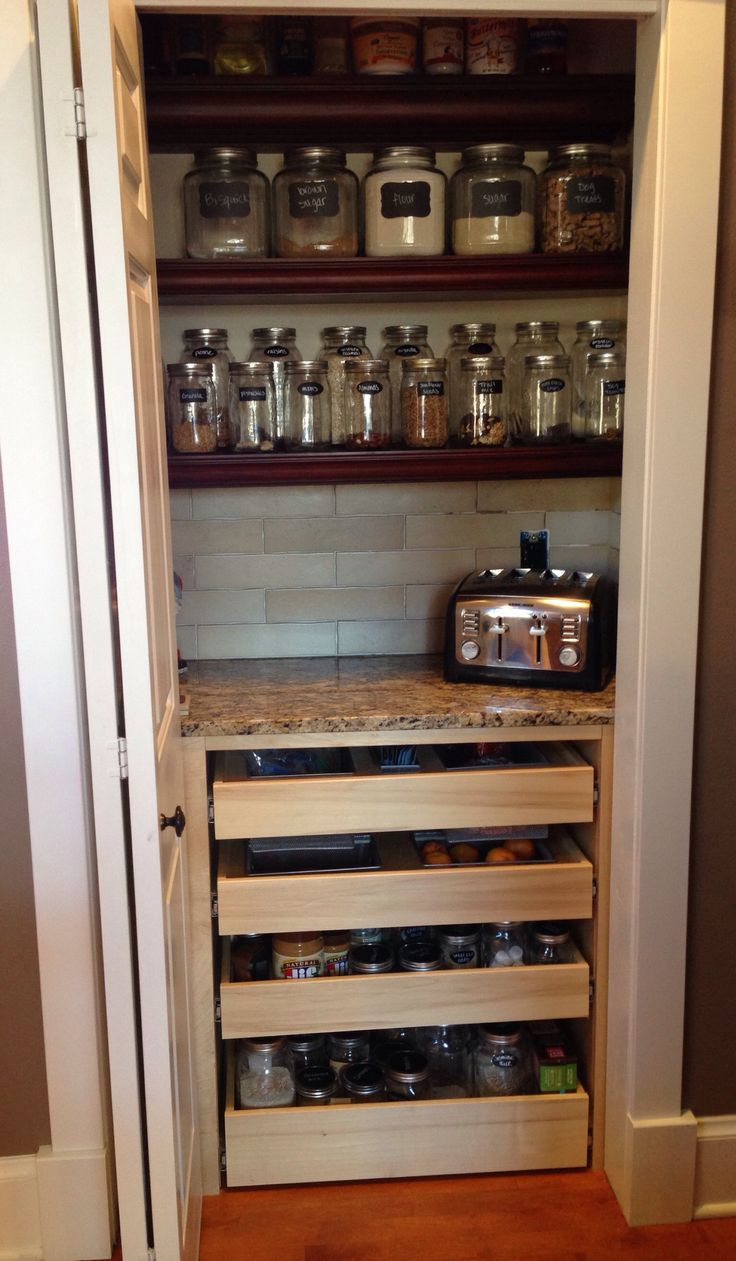 "My new organized pantry! A 47"" wide reach in pantry with 4 - 16"" deep builder grade shelves was replaced with a 4 drawer base unit, countertop for extra countertop appliances and 3 upper shelves. The lower two shelves are 10"" deep and the top is 5"" so items don't fall into the ""black hole"" of shelves that are too deep."