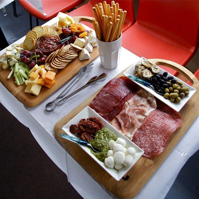 Antipasti and cheese boards. Did this for me and hubby. We were eating it for days,lol. With wine of course...........