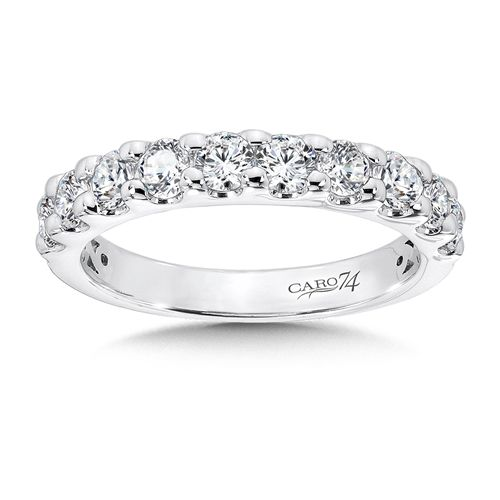 Stunning Anniversary Ring With A Row Of Round Diamond Accent Stones Set In White Gold