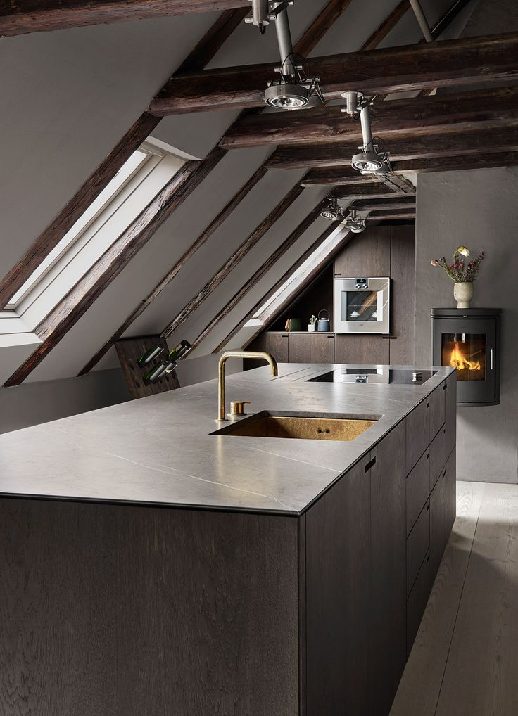 The owners chose to have Nicolaj Bo set up this tight and functional kitchen, which still manages to complement the history of the building and the neighborhood.