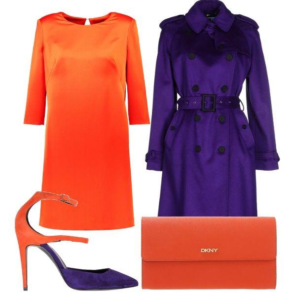Per questo outfit: vestito manica 3/4 arancione con scollo tondo, cappotto viola doppio petto lungo con cintura in vita, bellissime scarpe bicolore con tacco a spillo e cinturino alla caviglia, pochette DKNY arancione.