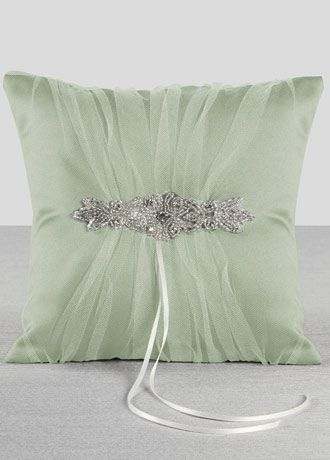 """Wrapped in delicate ivory tulle gathered over rich champagne satin, this ring bearer pillow is an elegant yet classic design. An elaborate rhinestone and beaded applique is the perfect embellishment for this radiant vintage style pillow. Features and Facts:   Size: 8"""" square  Made of satin and tulle with rhinestone and silver bead embellishment"""