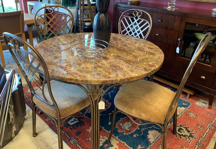 The Golden Brown Stone Of The Table Top Of This Dining Set Is Complimented By Bronze Tone Balloon Back Chairs 48 Dia Home Decor Trends Dining Table Furniture
