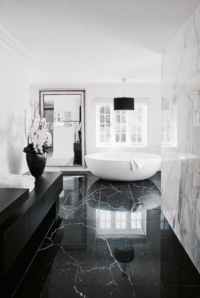 bathroom with contrasting marble floor and walls