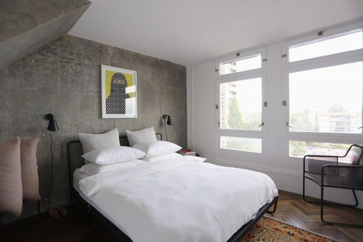 Bedroom with concrete walls