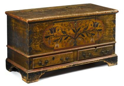 Painted and decorated dower chest    pennsylvania, late 18th century    Rectangular hinged top with molded edge opening to well with till, the base decorated with shaped reserve enclosing vase of flowers, the corners decorated with hearts, above two thumb-molded drawers and molded bracket base.    H: 28 in. W: 51 in. D: 23 1/4 in. Sold for $3,500