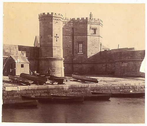 Fort Macquarie ca.1870 from Sydney Streets and Buildings, 1861-ca.1900 State Library of NSW collection.  Notes: Fort Macquarie was built on the end of Bennelong Pt. Completed by convict labour in 1821 using stone from the Domain, the fort had 15 guns and housed a small garrison.  The fort was demolished in 1901 to make way for the tramway sheds that occupied the site until the construction of the Utzon masterpiece, the Sydney Opera House