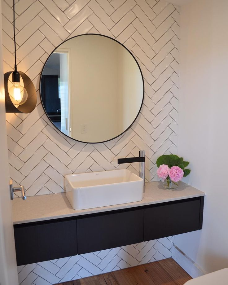Gorgeous! Herringbone feature, floating vanity and lighting. No black on vanity.