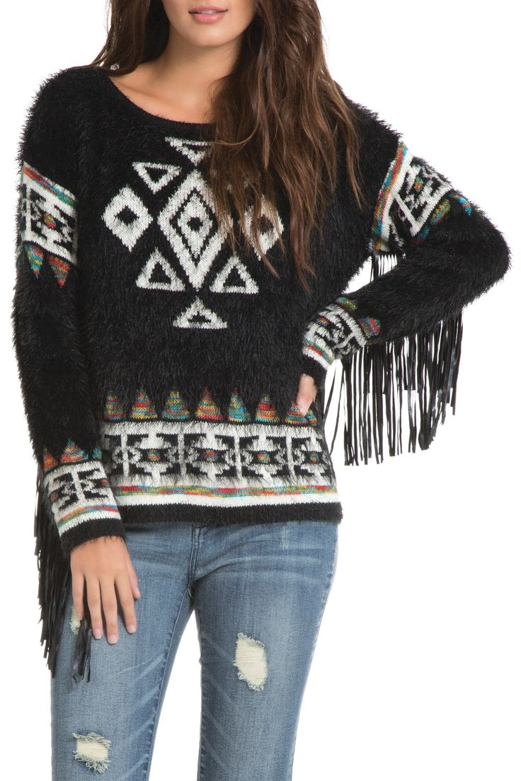 Long sleeve aztec knit sweater with pleather fringe detailing on the sleeves.  Faux Leather Fringe Sweater by Elan. Clothing - Sweaters - Crew & Scoop Neck Iowa