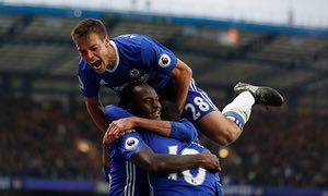 Cesar Azpilicueta celebrates Chelsea's third goal against  Manchester United at Stamford Bridge in October 2016 with Victor Moses and Eden Hazard