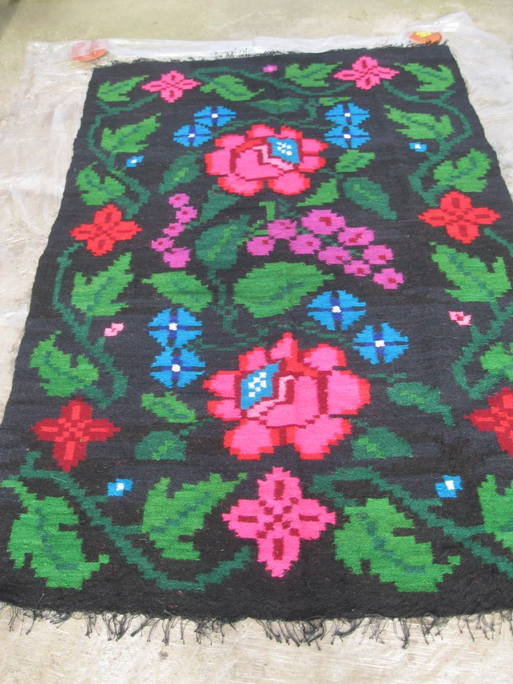 Beautiful antique traditional Romanian woven wool carpet / rug with floral pattern. Hand woven in Northern Transylvania 50 - 70 years ago. At www.greatblouses.com