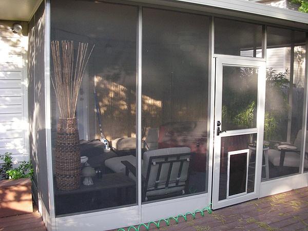 Best 25 dog screen door ideas on pinterest front screen for Front door with screen built in
