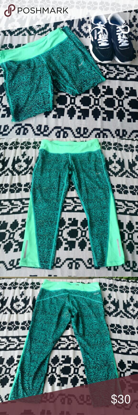 "Teal Nike Leopard Dri-Fit Capri Cute pre-owned Capri compression pants in excellent condition. No flaws. Waist measures 13"", inseam measures 21"".   Offers are always welcome!  E&T Nike Pants Capris"