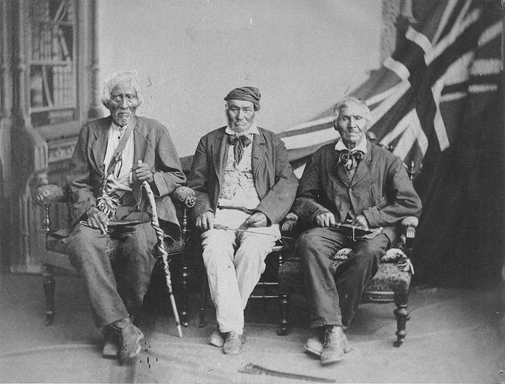 """1882 studio portrait of the (then) last surviving Six Nations warriors who fought with the British in the War of 1812: (left to right) Sakawaraton a.k.a. John Smoke Johnson (born circa 1792), John Tutela (born ca. 1797) and Young Warner (born ca. 1794). Portrait taken in Brantford, Ontario, Canada."""