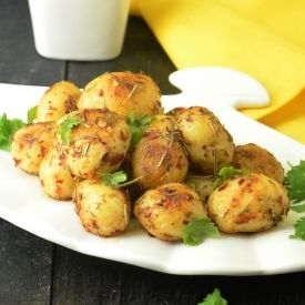 Baby potatoes tossed with butter, chili and herbs.