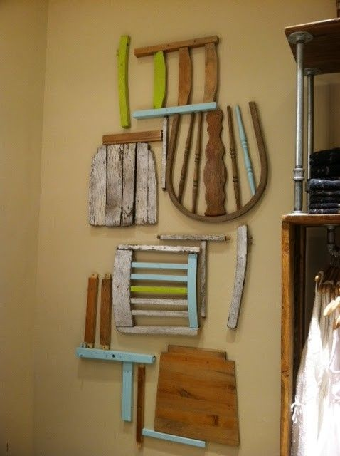 Not sure what to put on those bare walls? Break down a chair found at Goodwill! Paint all the parts different colors for a fun and funky touch or sand them down for something more rustic.