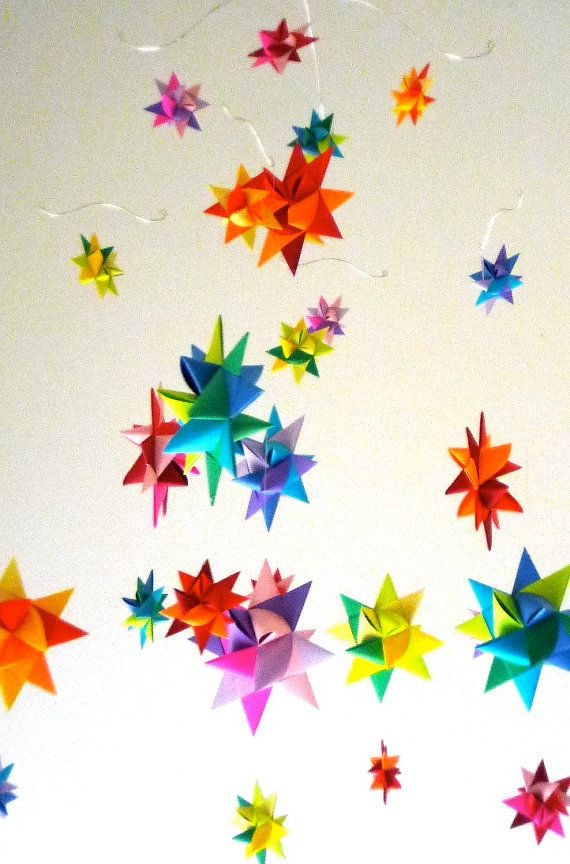 Modern Baby Mobile Hanging Origami Stars by theStarcraft on Etsy.  - Part of what makes these stars look different is that they have been dipped in wax.  I like it as a mobile. Very colorful!