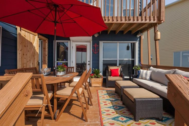 As seen on Beach Flip, contestants Martha and Alex completely redesigned the beach deck at the renovated Comfort Breeze condo. They removed the old and broken plastic furniture and repainted the house and deck along with adding a new dining table, a comfortable seating area and a beautiful sliding barn door to separate access from their duplex neighbors.