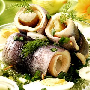 Herring In Scandinavia, this saltwater fish — which is caught during spring around Easter time — is enjoyed in one of many preparations: pickled, raw, or cured. Traditionally, the delicacy is served on a bun or alongside rye bread, potatoes, sour cream, and akvavit, a special-occasion Schnapps. Search for herring recipes.