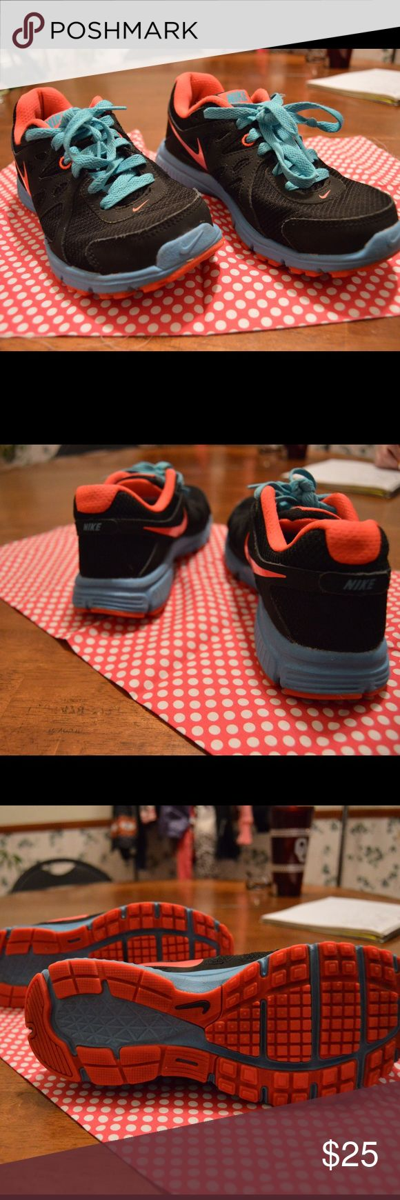 Ladies Nike shoes Nike Revolution 2, ladies. Size 6. Slightly worn. Black, pink and blue Nike Shoes Athletic Shoes